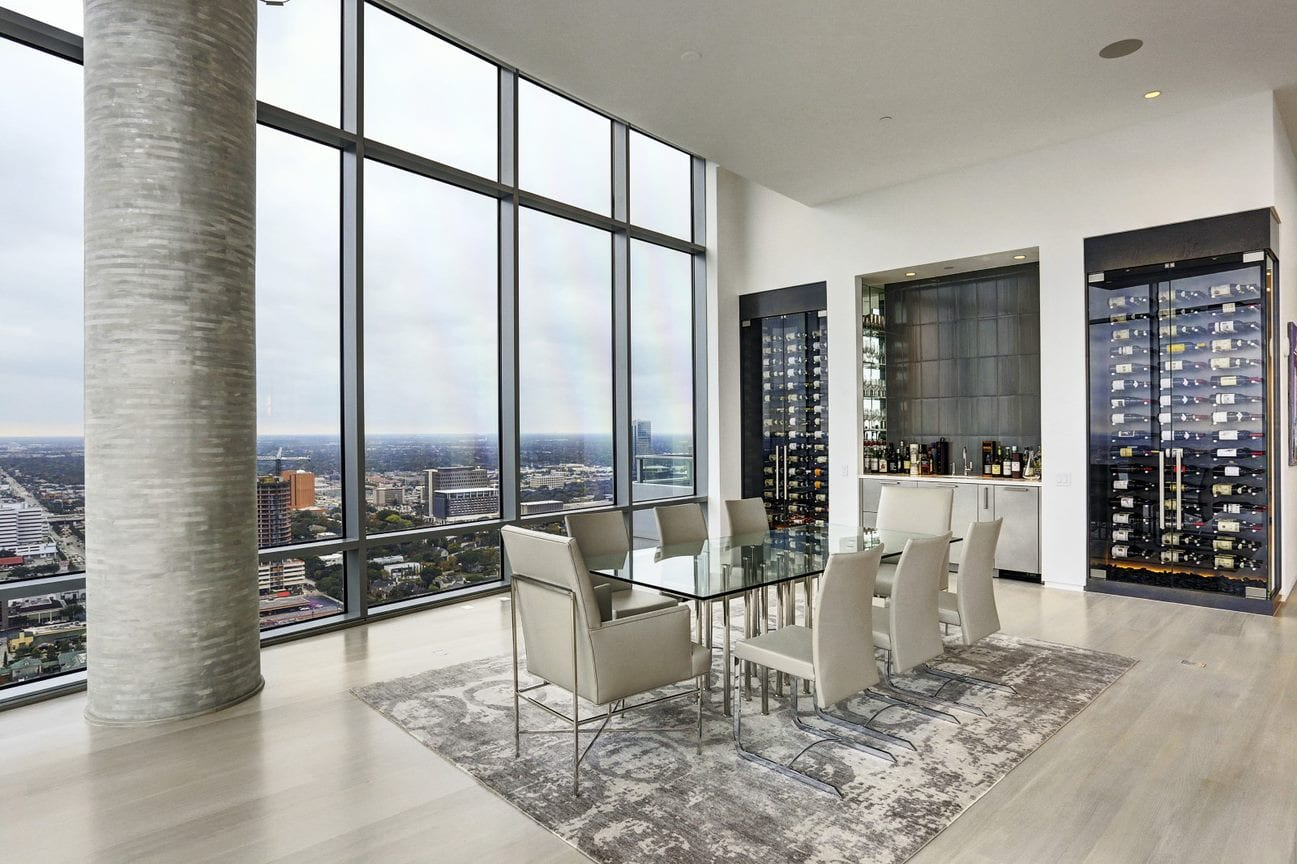 dining room with view of downtown houston of the east penthouse in the 2727 kirby luxury high rise