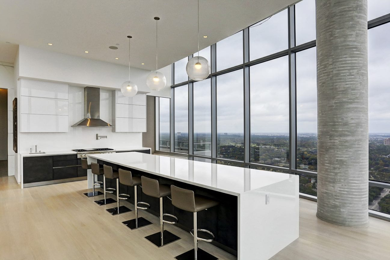 angled photo of the luxury german kitchen by eggersmann of the east penthouse in the 2727 kirby luxury high rise condos in houston