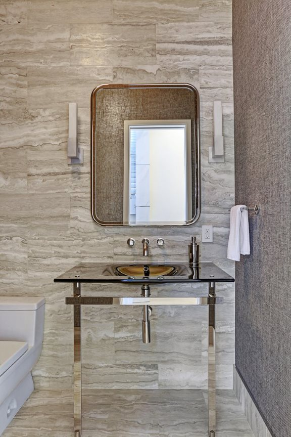 high-end powder room of the east penthouse in the 2727 kirby luxury high rise condos in houston