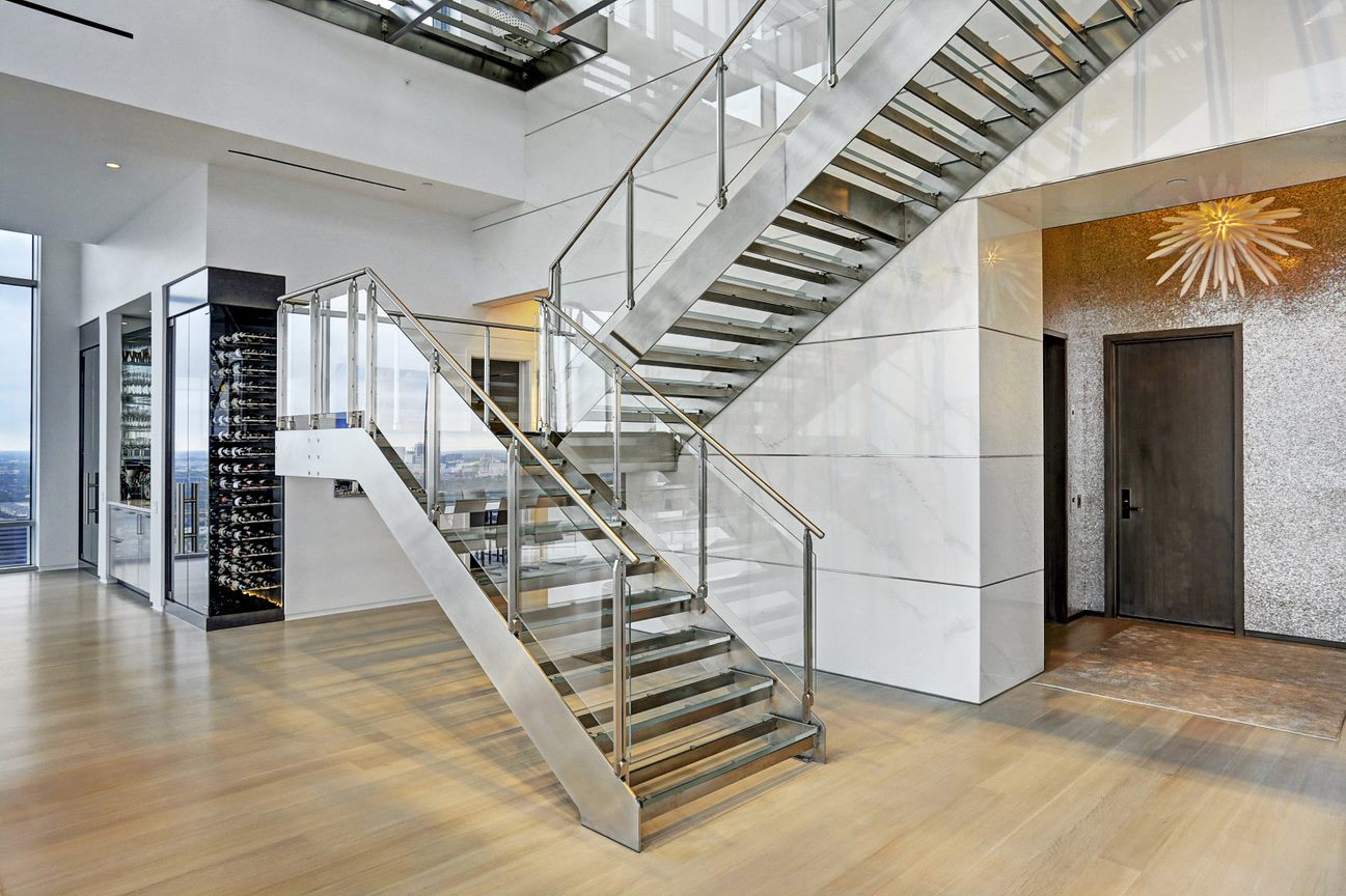 stainless steel architecture staircase in the east penthouse in the 2727 kirby luxury high rise condos in houston