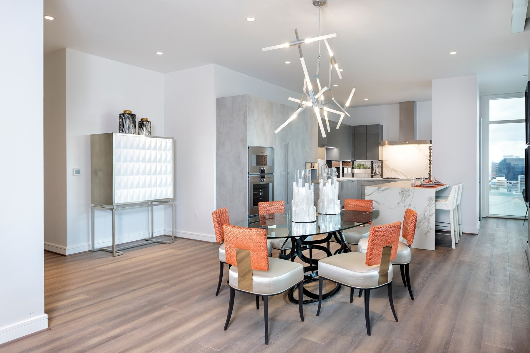 dining area of the eggersmann bespoke kitchen in the model unit of arabella luxury condos in houston