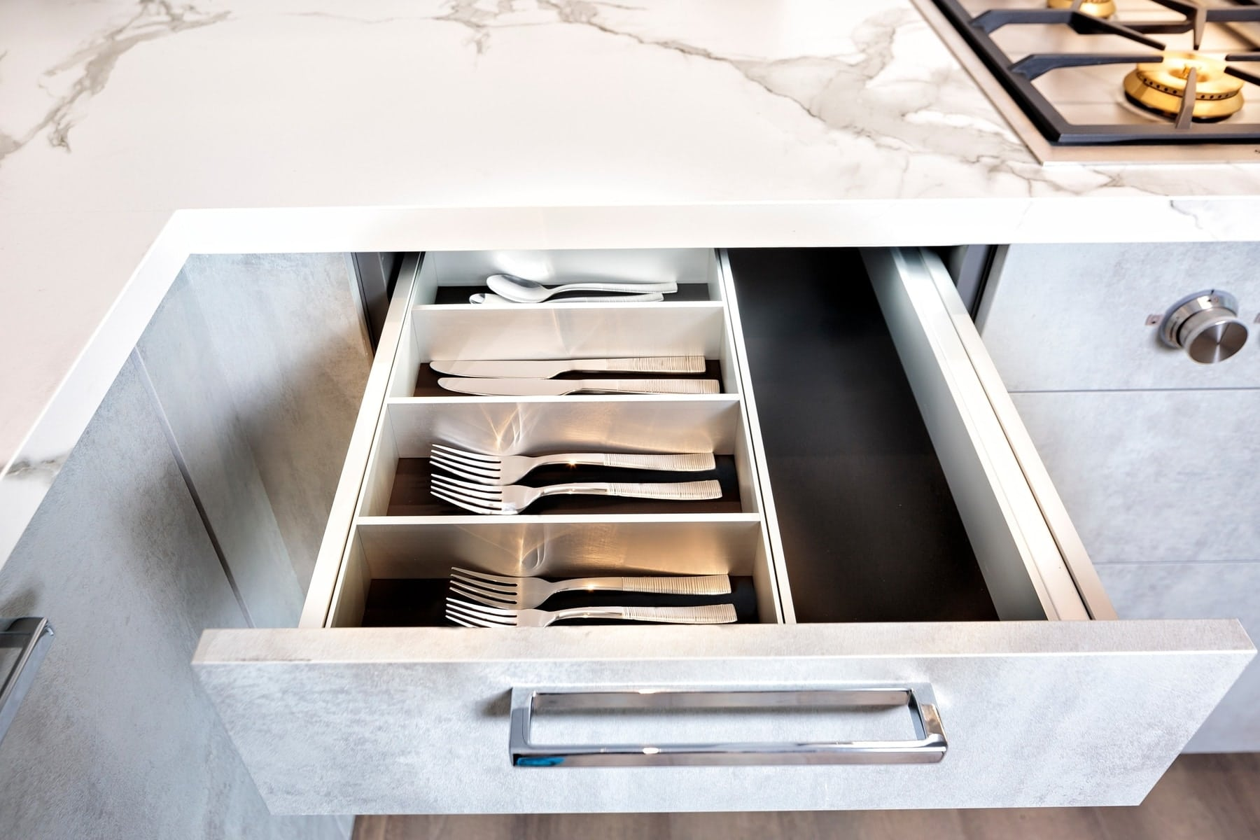 eggersmann boxtec flatware drawer organizer in the kitchen of the model unit of arabella luxury condos in houston