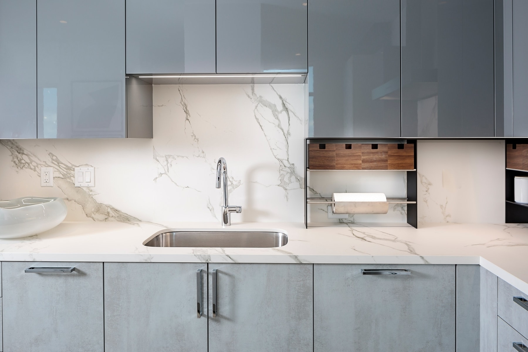kitchen sink and german cabinetry in the model unit of arabella luxury condos in houston