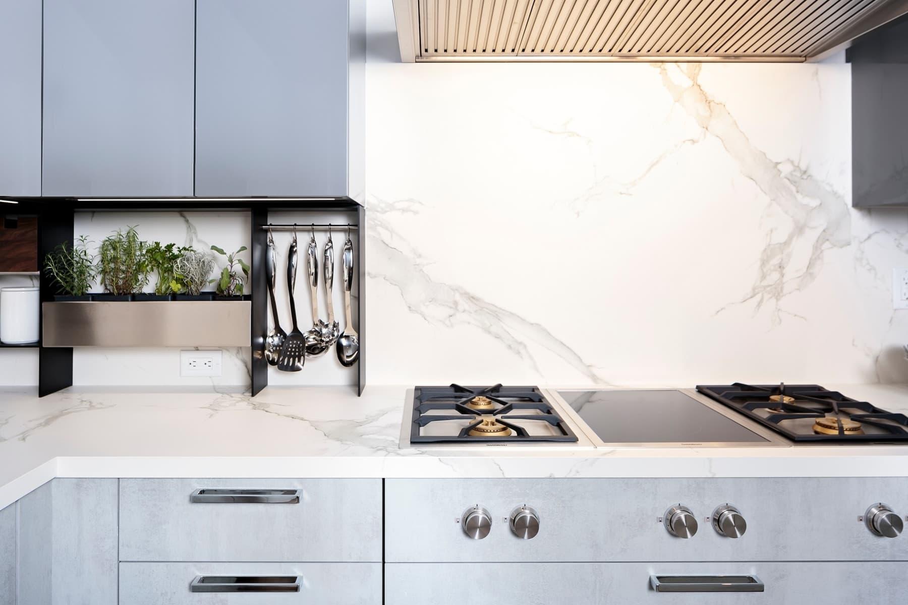 gaggenau stove and eggersmann's 15 square backsplash of the model unit of arabella luxury high rise condos in houston