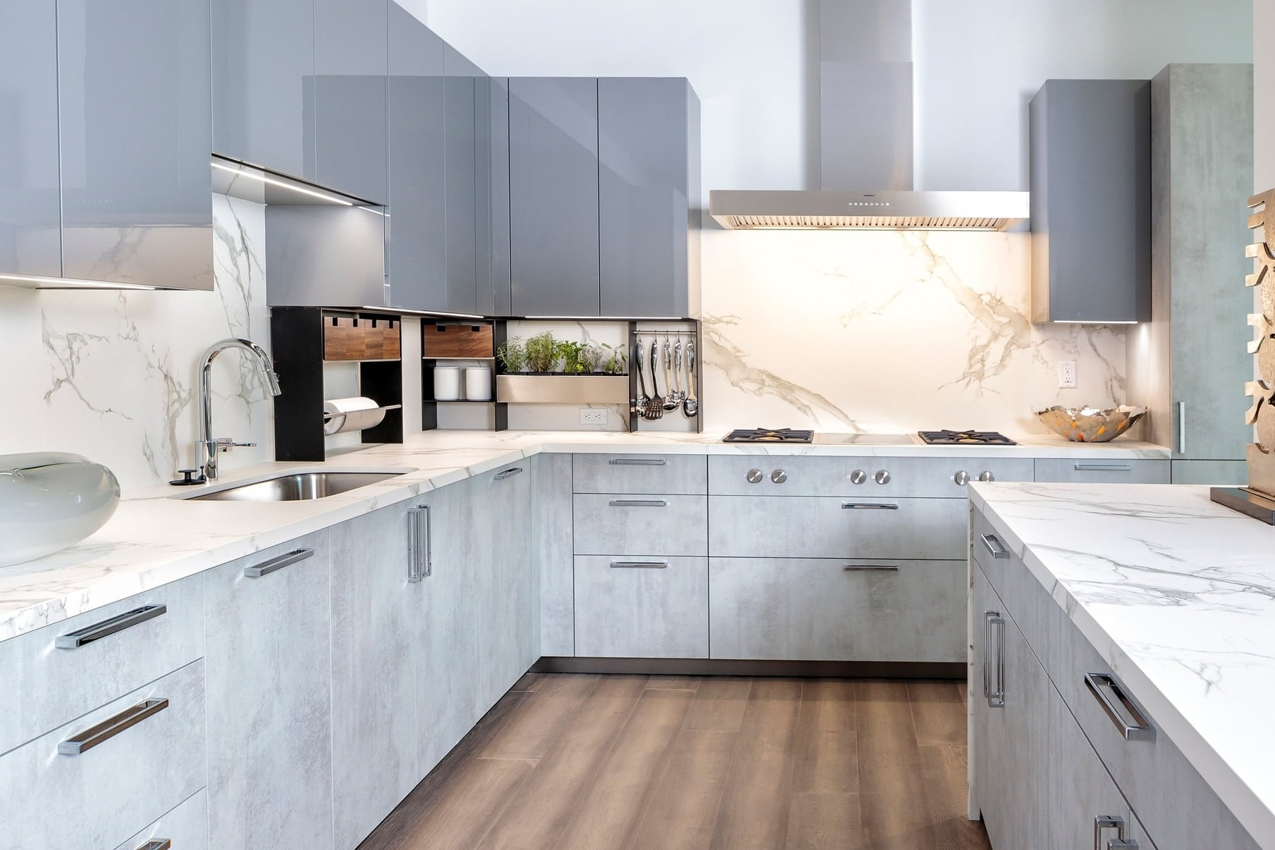 eggersmann luxury kitchen with two-tone cabinets and marble countertops