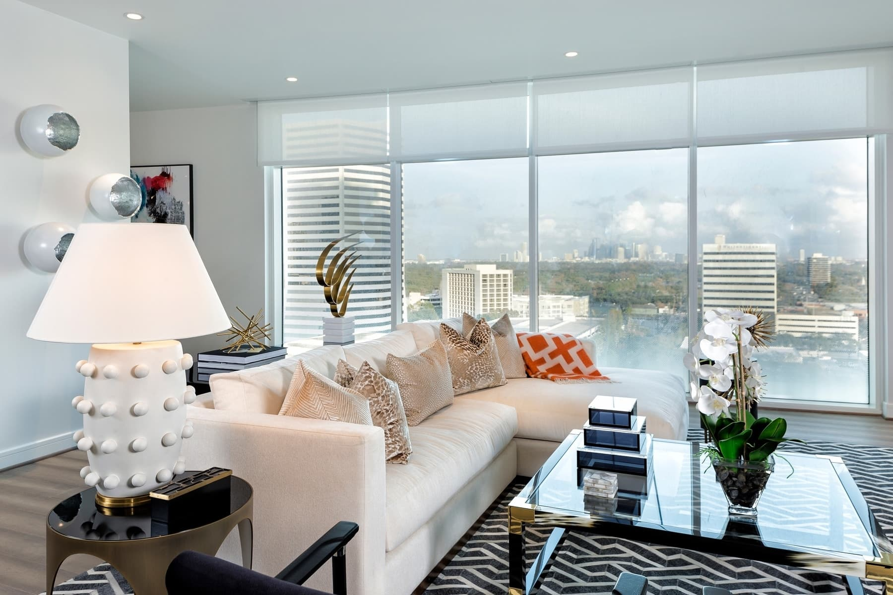 living area with panoramic views of downtown houston in the model unit of arabella luxury condos in houston