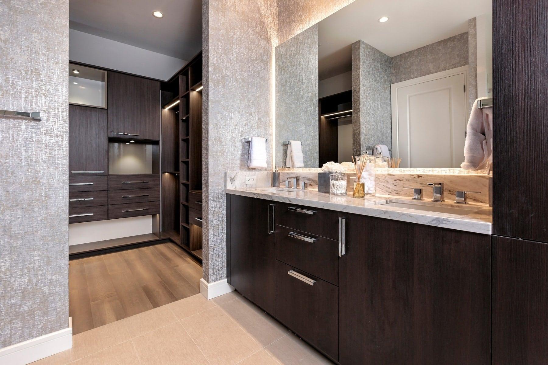 master bathroom and custom walk-in closet in the model unit of arabella luxury condos in houston