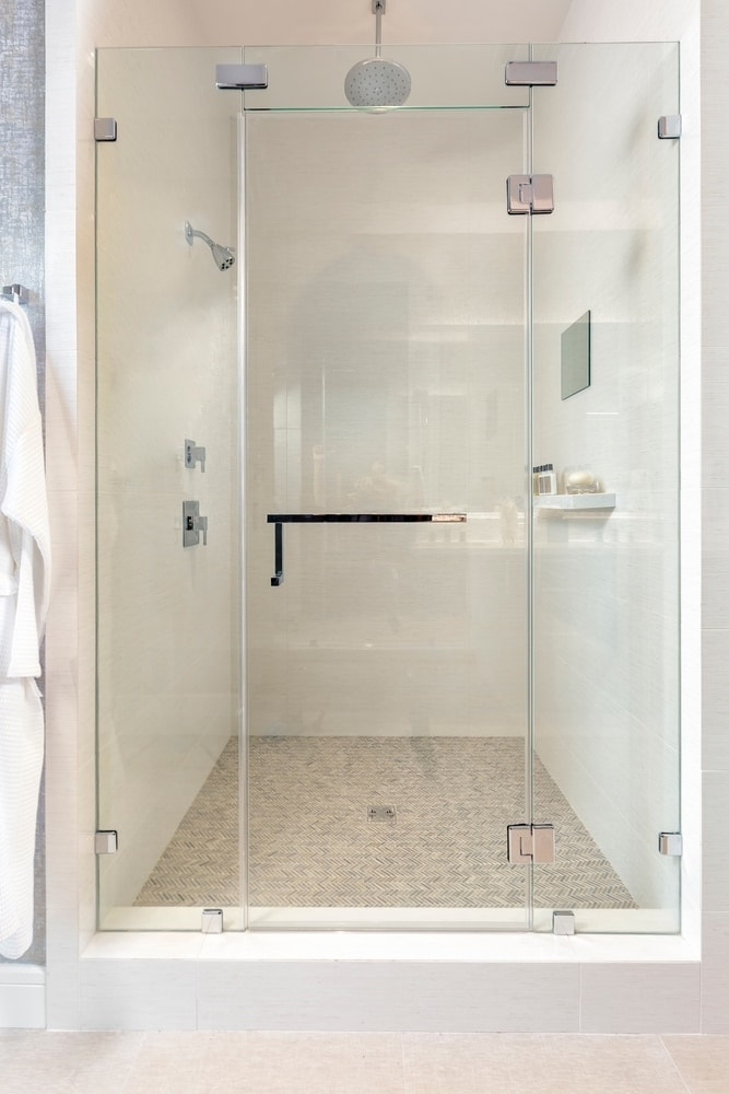 custom shower in the master bath of the the model unit of arabella high rise in houston