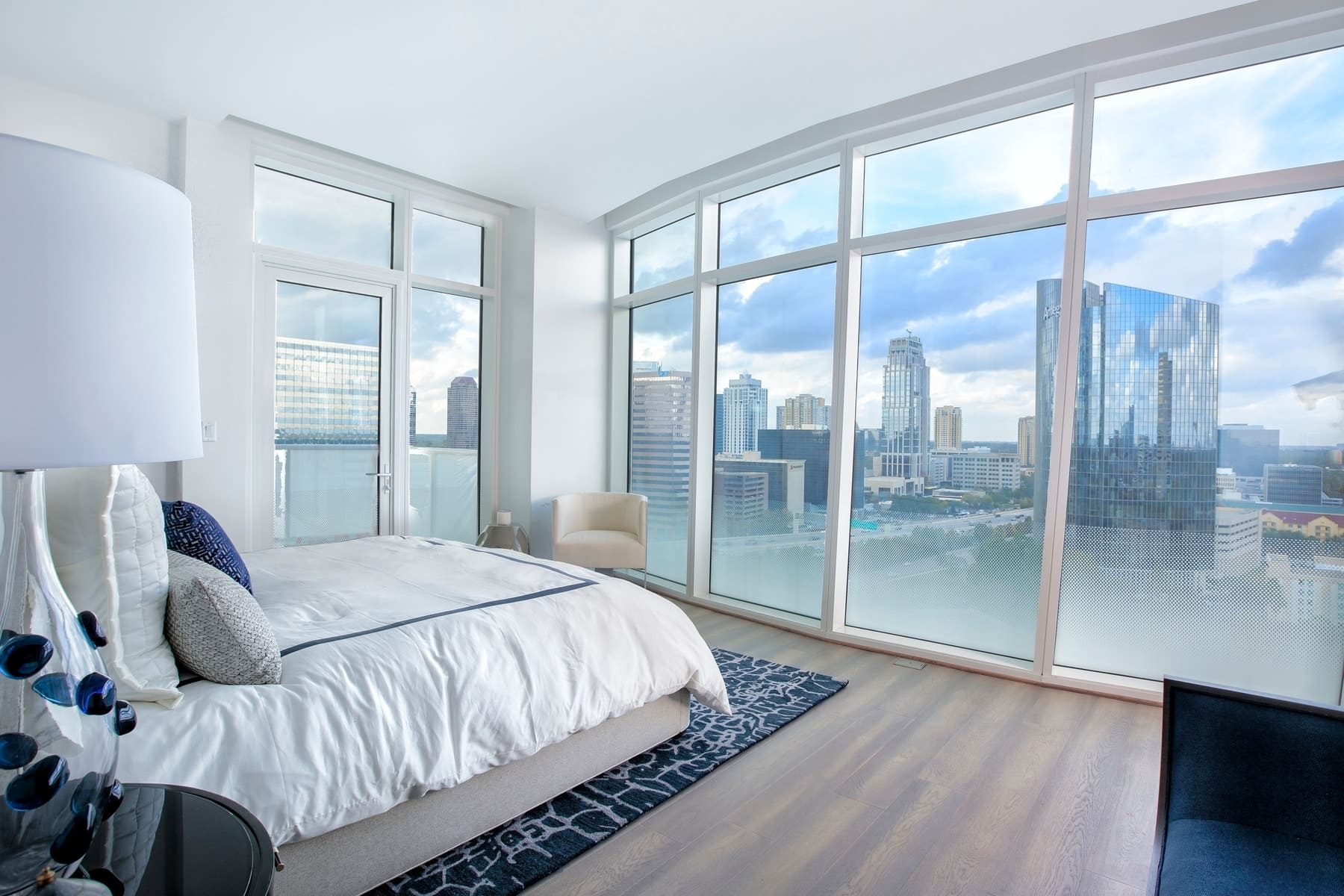 master bedroom with panoramic view of uptown houston from the model unit of arabella luxury condos in houston