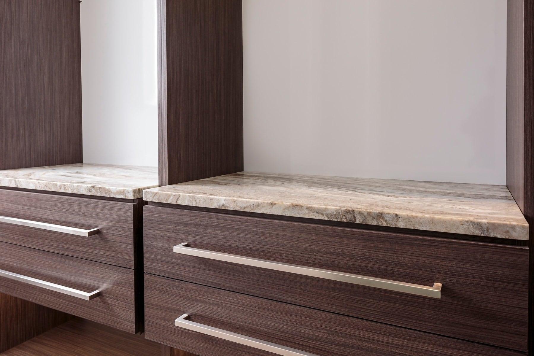 custom drawers in a schmalenbach wardrobe designed by eggersmann in the model unit of arabella luxury condos in houston
