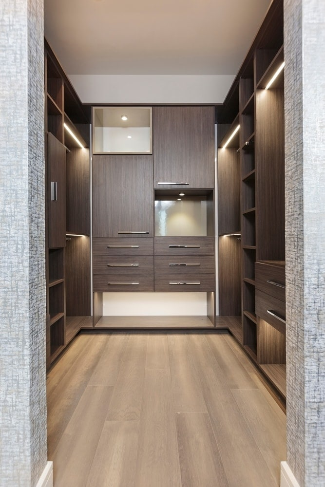 master walk-in closet using schmalenbach cabinetry in the model unit of arabella high rise condos in houston