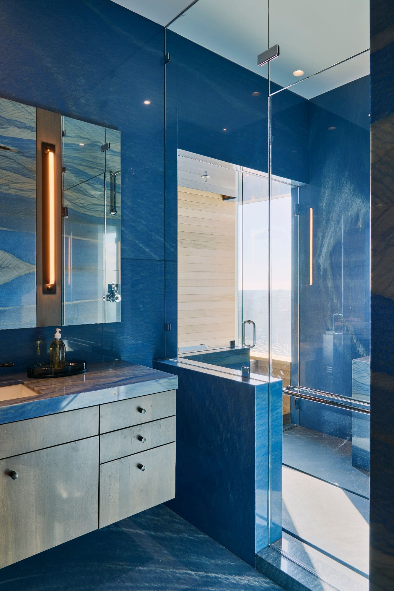 """""""his"""" blue marble master bath inside a penthouse of the arabella luxury high rise in houston"""