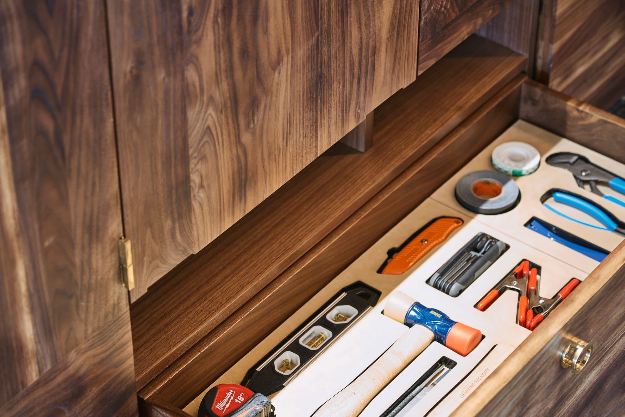 custom tool draw molded to exactly fit household tool necessities inside a penthouse of the arabella luxury high rise in houston