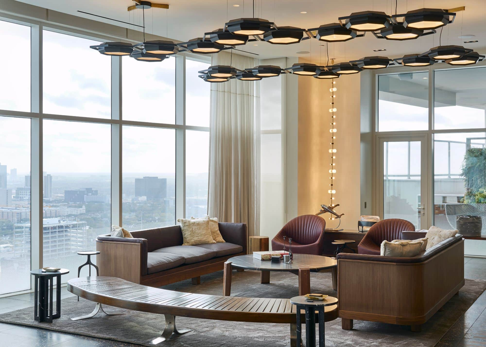 living room with panoramic view of houston inside a penthouse of the arabella luxury high rise