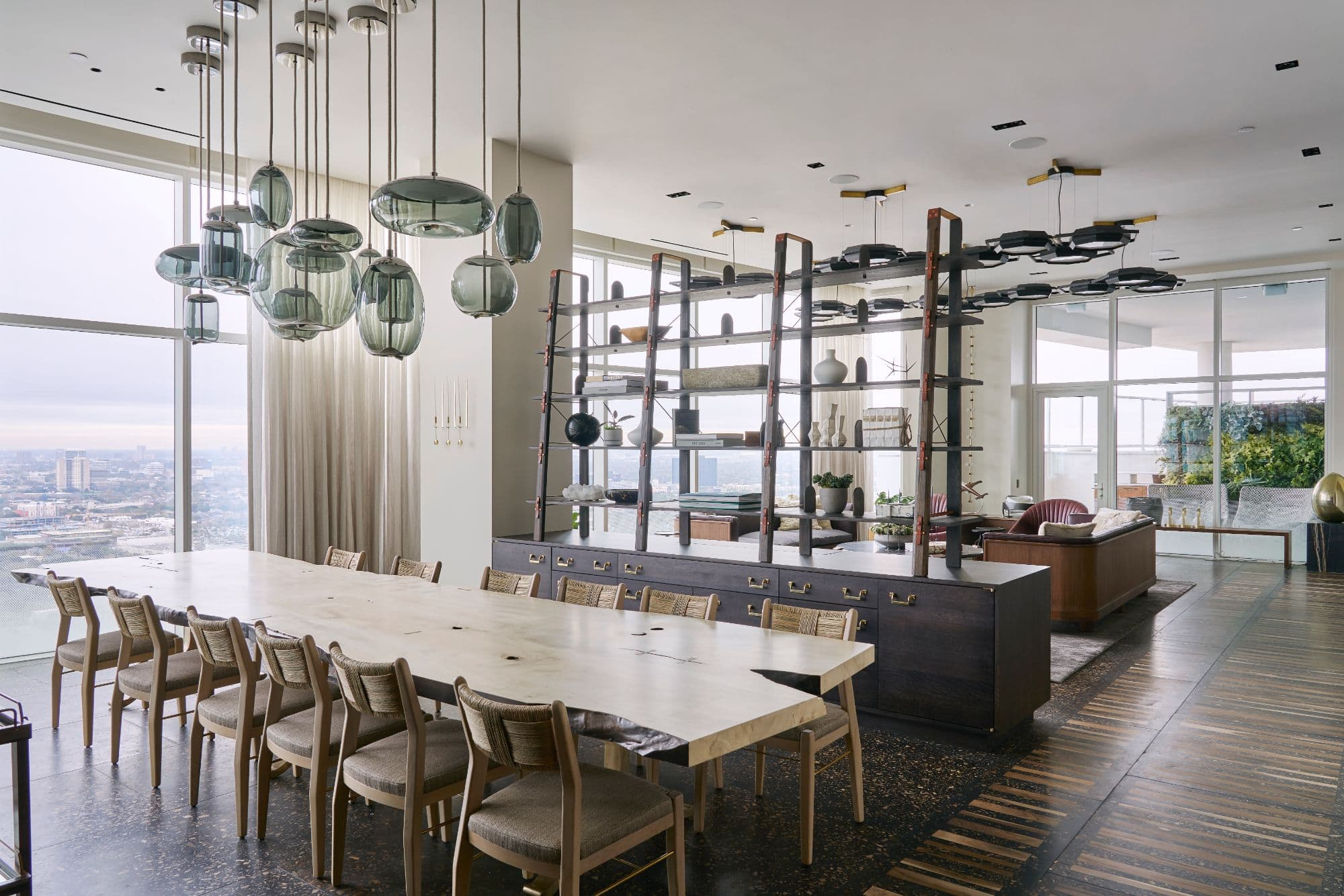 dining area with ultra-modern chandelier inside a penthouse of the arabella luxury high rise in houston