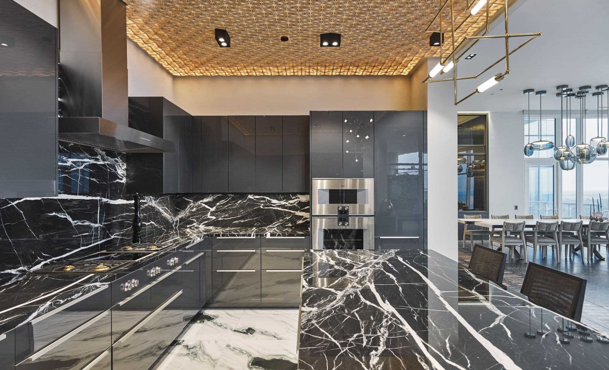 eggersmann kitchen with white-veined black marble and gaggenau appliances inside a penthouse of the arabella luxury high rise in houston