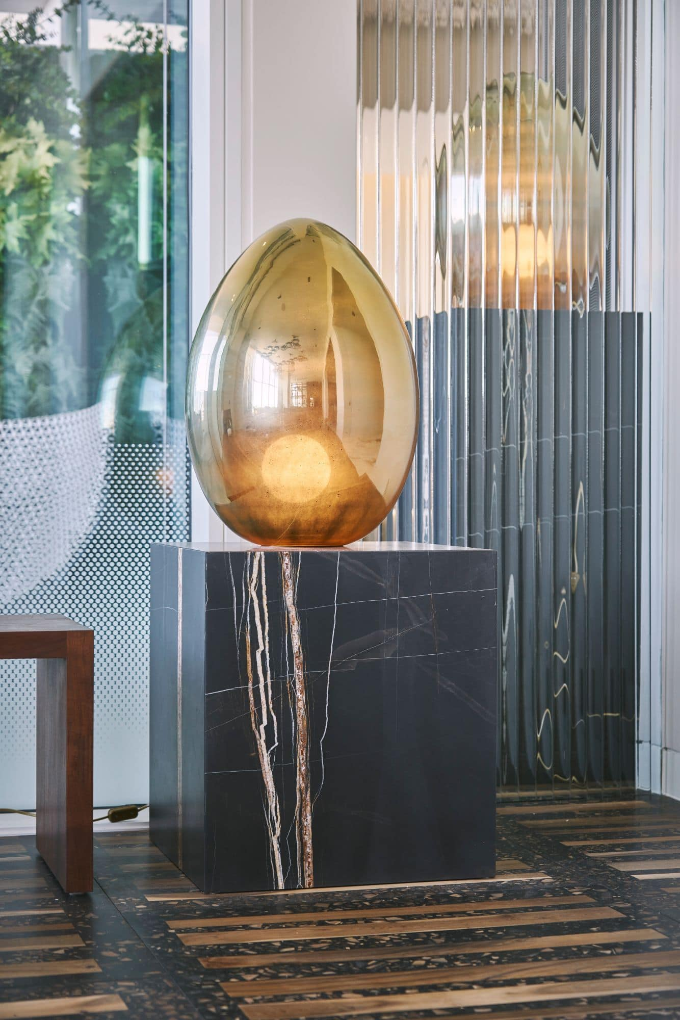 sculptural lighting inside a penthouse of the arabella luxury high rise