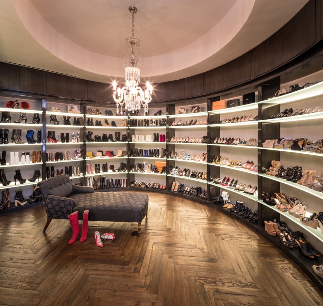 expansive luxury shoe storage in a high-end walkin closet of a full floor renovation of the huntingdon higrise on kirby in houston