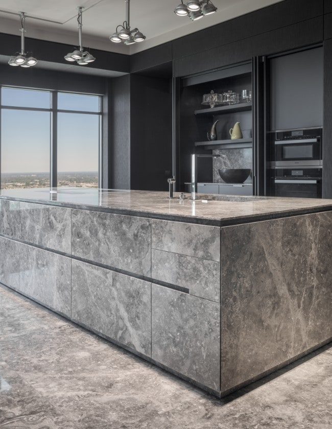 contemporary stone kitchen with ample hidden storage in the huntingdon luxury high-rise condos on kirby in houston