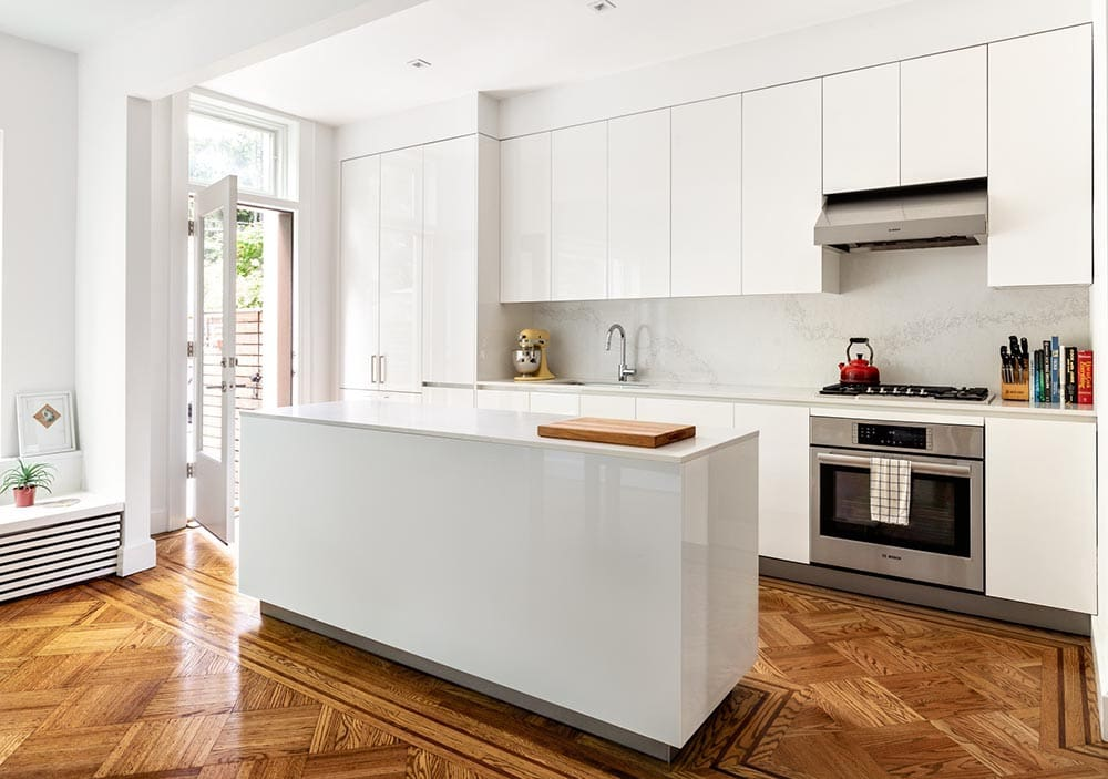 example installation of the dallas icy white gloss finish used for kitchen cabinets in the eggersmann designed condos for the parklane houston when the divinely urban collection is chosen