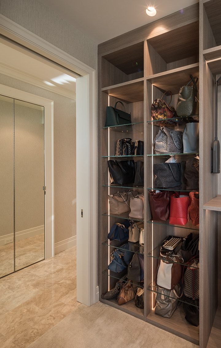 handbag display and storage in a custom Schmalenbach closet for hercustom-designed belfiore great room with eggersmann kitchen