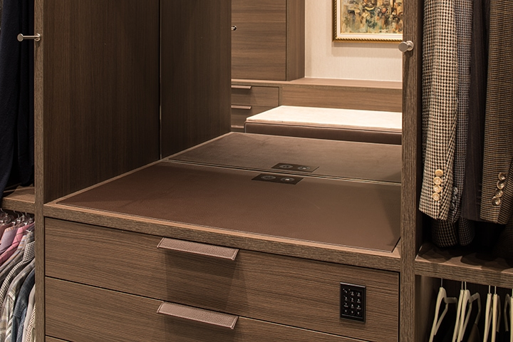 vanity with flush outlets in a Schmalenbach closet for him