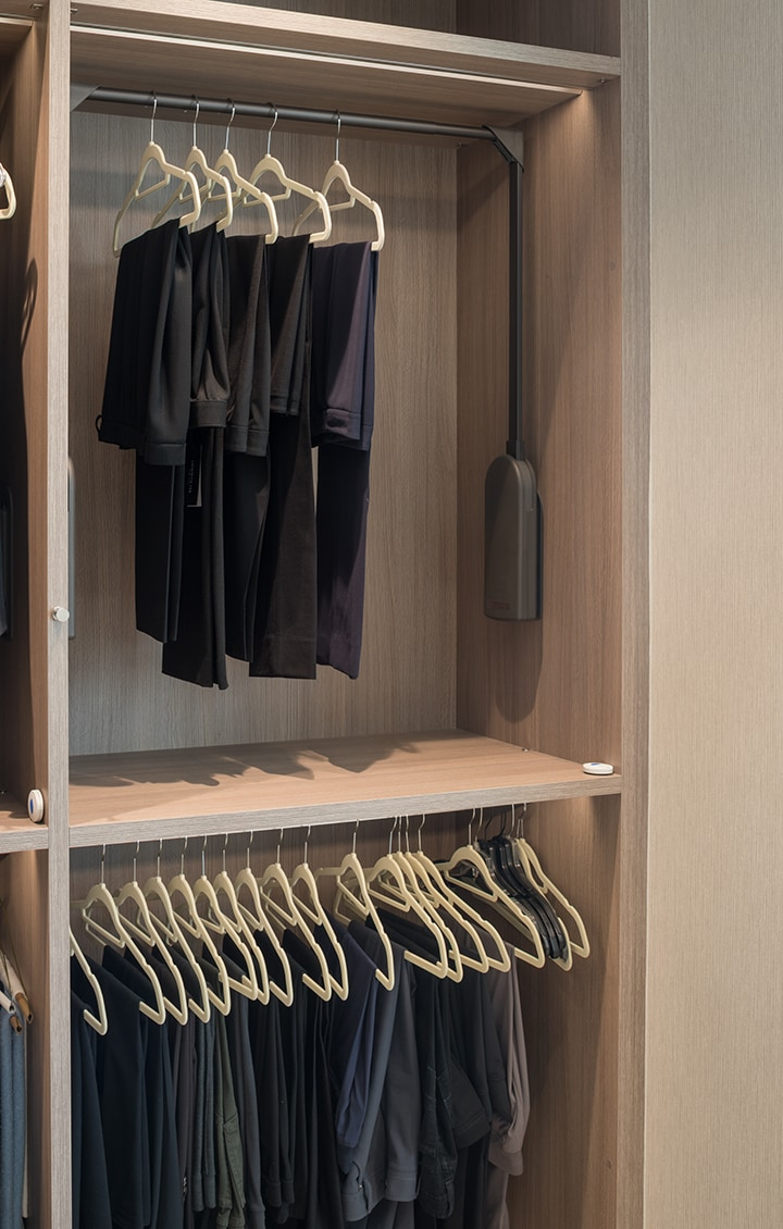double clothes hanging in a Schmalenbach closet for her