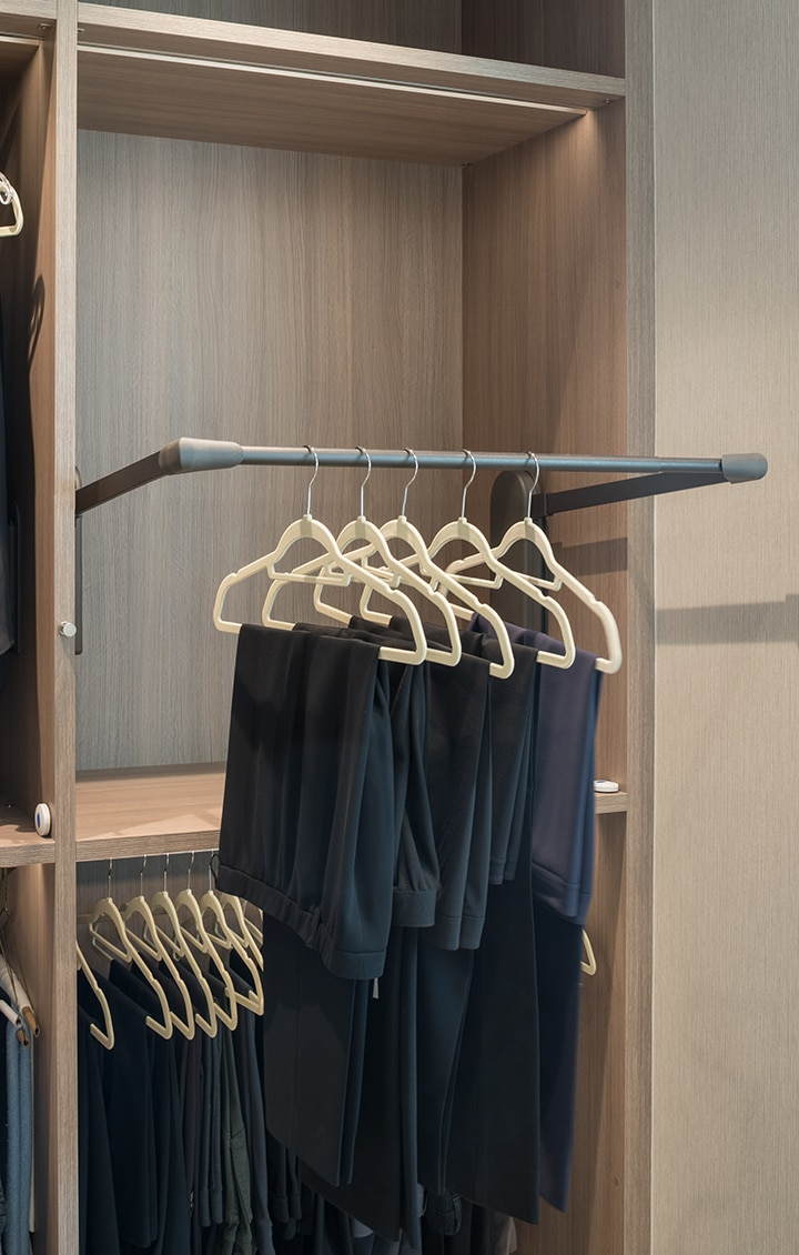 push-button automatic tilt-down clothes hanging in a Schmalenbach closet for her