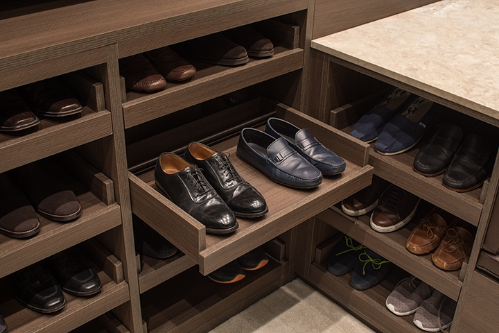 custom shoe trays in a Schmalenbach closet for him