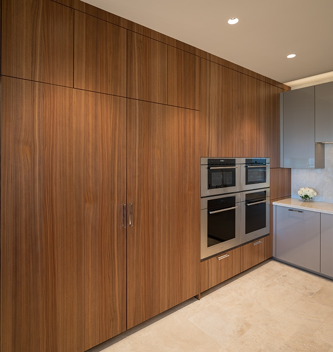 floor-to-ceiling storage in wood tones with wolf appliance collection in an eggersmann kitchen in belfiore condos in houston