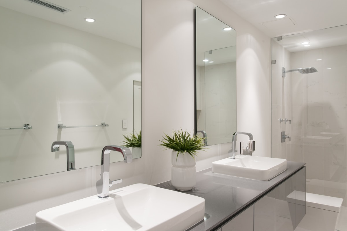 minimalist sinks and chrome fixtures