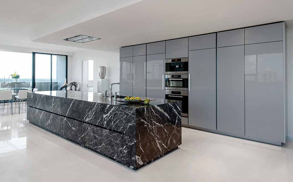 unique stone island in Grigio Carnico marble and Silver Metallic Acrylux Calgary cabinetry finish