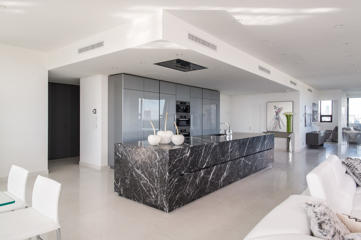 luxury custom kitchen in black, gray, and white