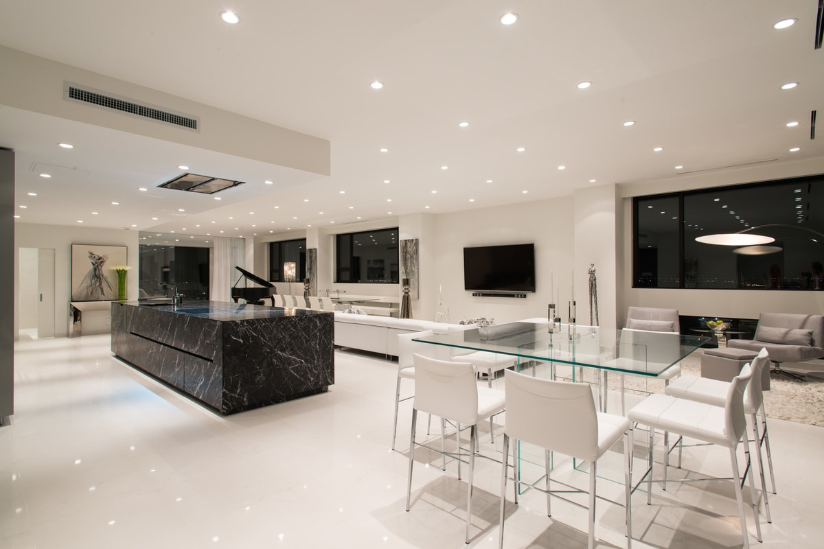 dining area next to elegant stone kitchen