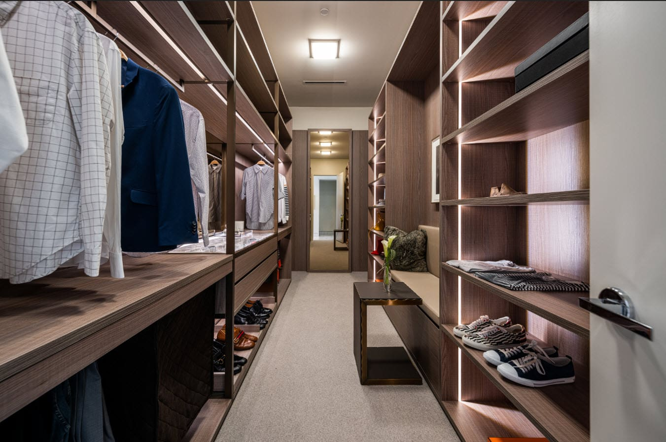 luxury walk-in closet designed by eggersmann and custom manufactured by schmalenbach for hall arts residences in dallas texas