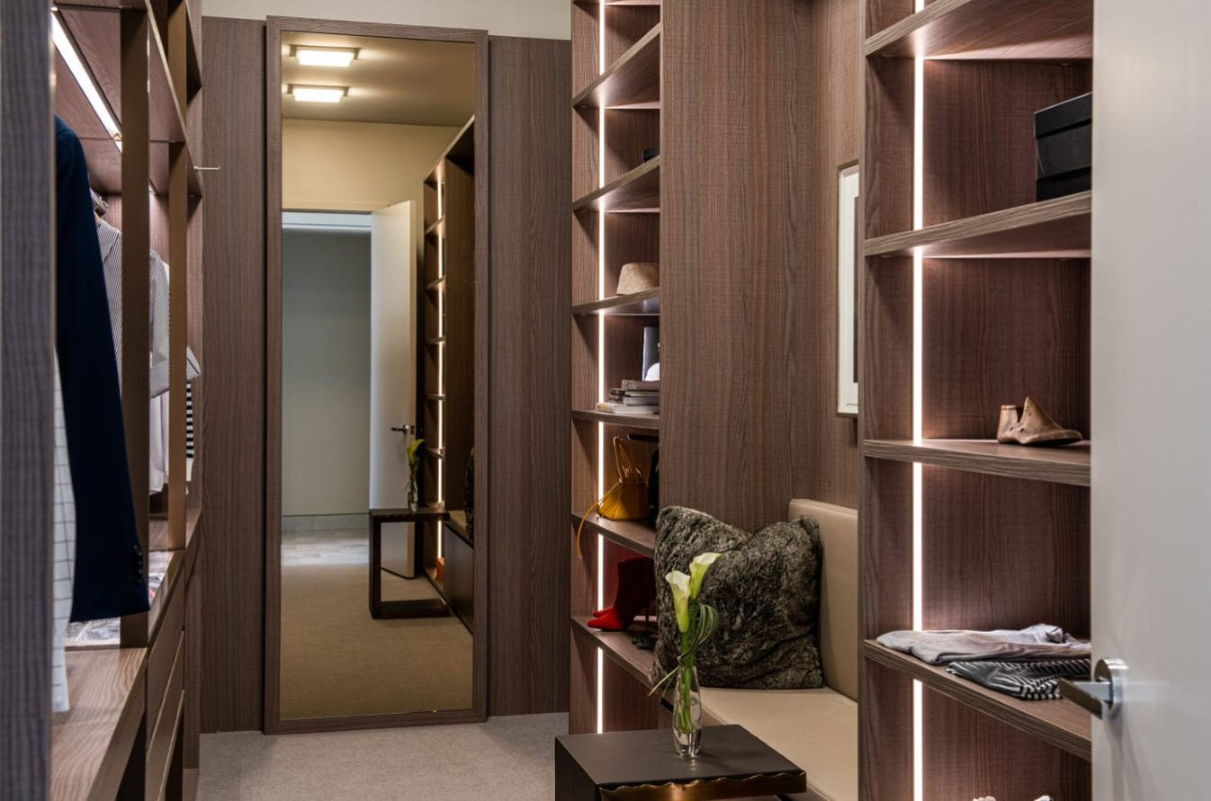 luxury walk-in closet featuring built-in led lightingdesigned by eggersmann and custom manufactured by schmalenbach for hall arts residences in dallas texas