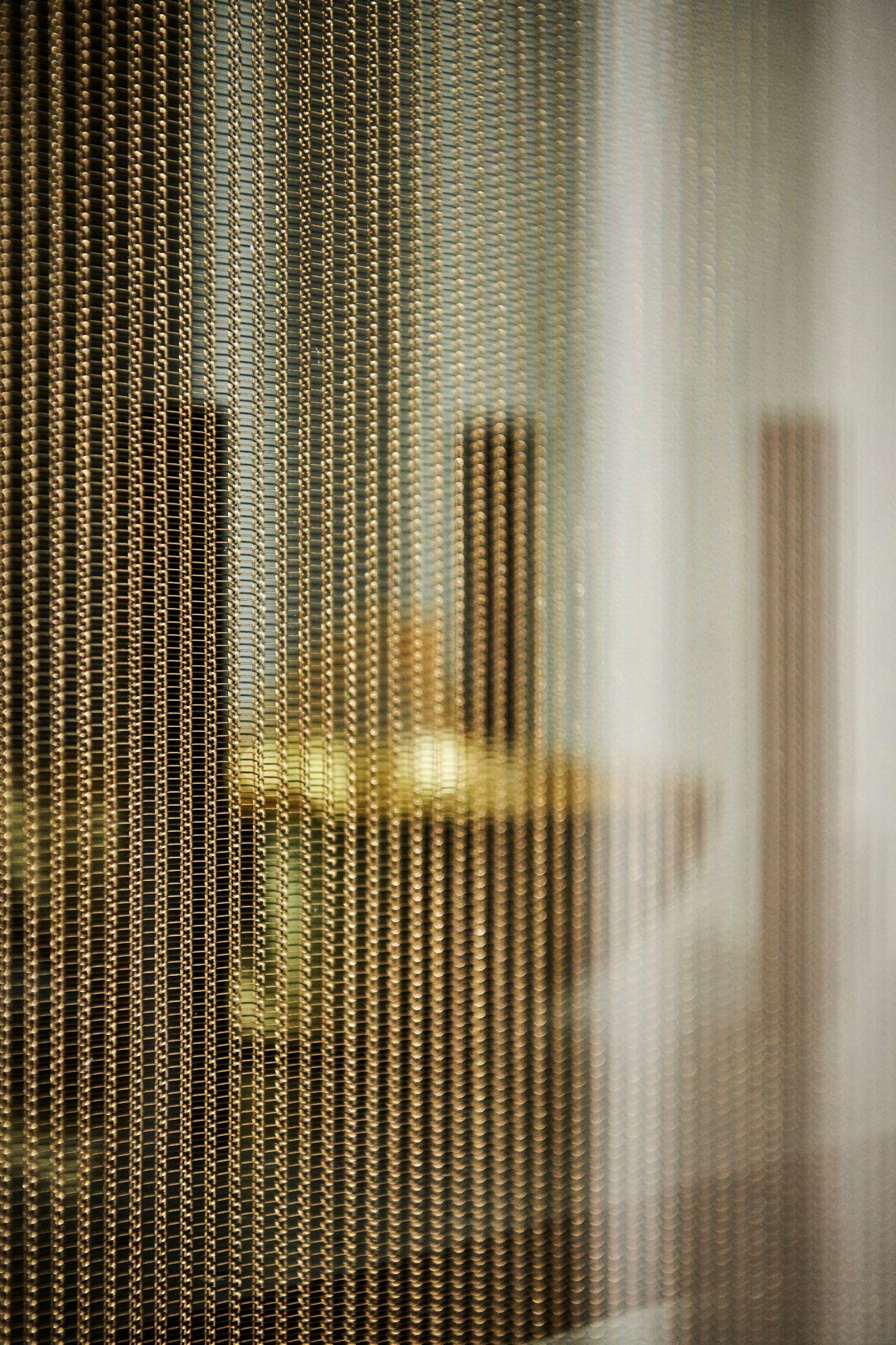 closeup of eggersmanns' exclusive Interlink glass finish in bronze