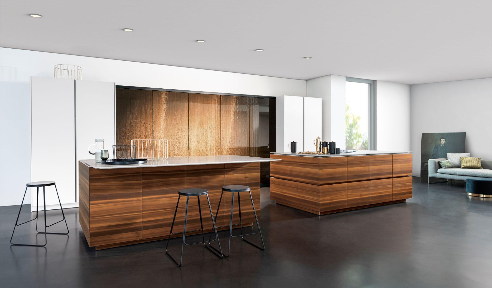 eggersmanns' exclusive Interlink glass finish in bronze applied to work's turnstile pantry doors
