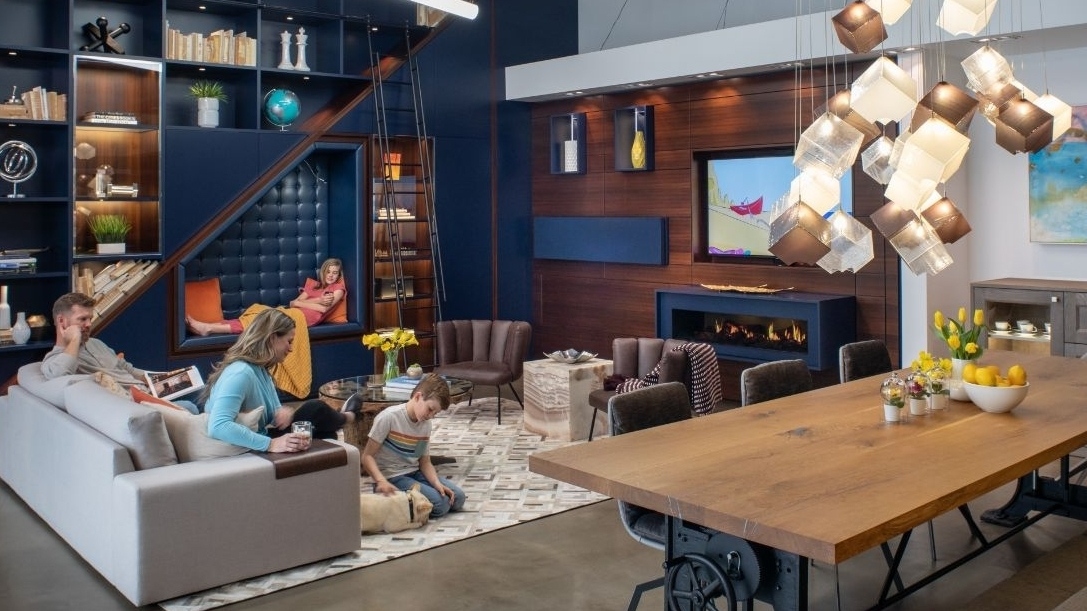family enjoying a luxury living and media room design by eggersmann