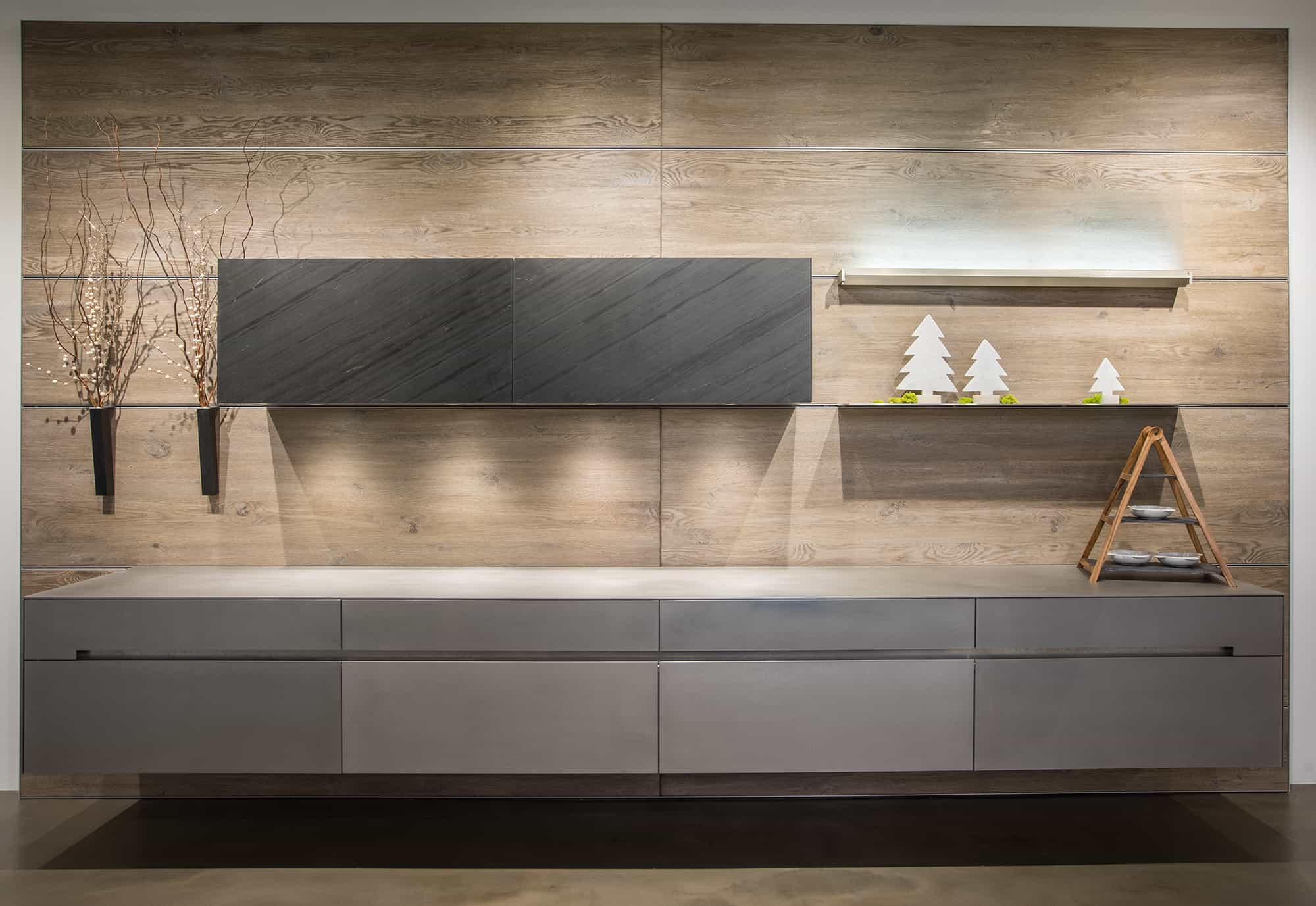 suspended credenza in Vancouver Brushed Oak Silverbrown | SilverTouch Stainless Steel finish with Phyllite Black Leather quartz