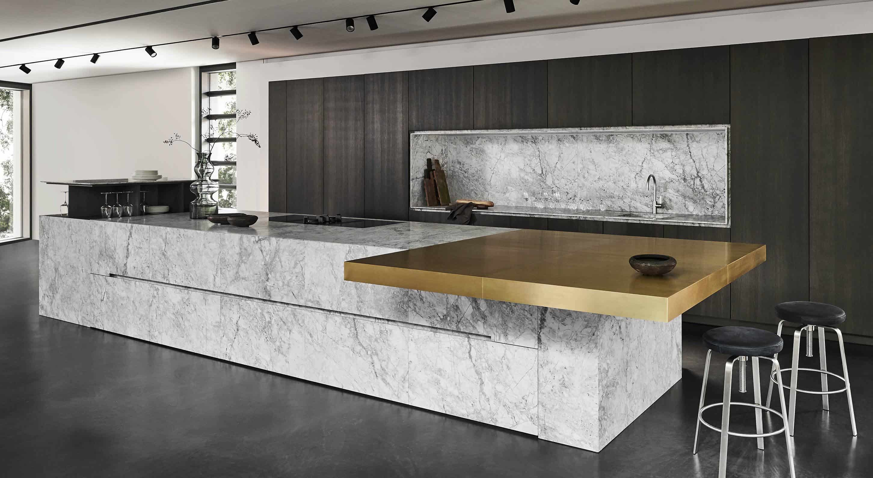 custom eggersmann kitchen using the unique cabinetry collection with Bianco Nuvola Quartzite, Brushed Brass, and Core Ash Veneer finishes