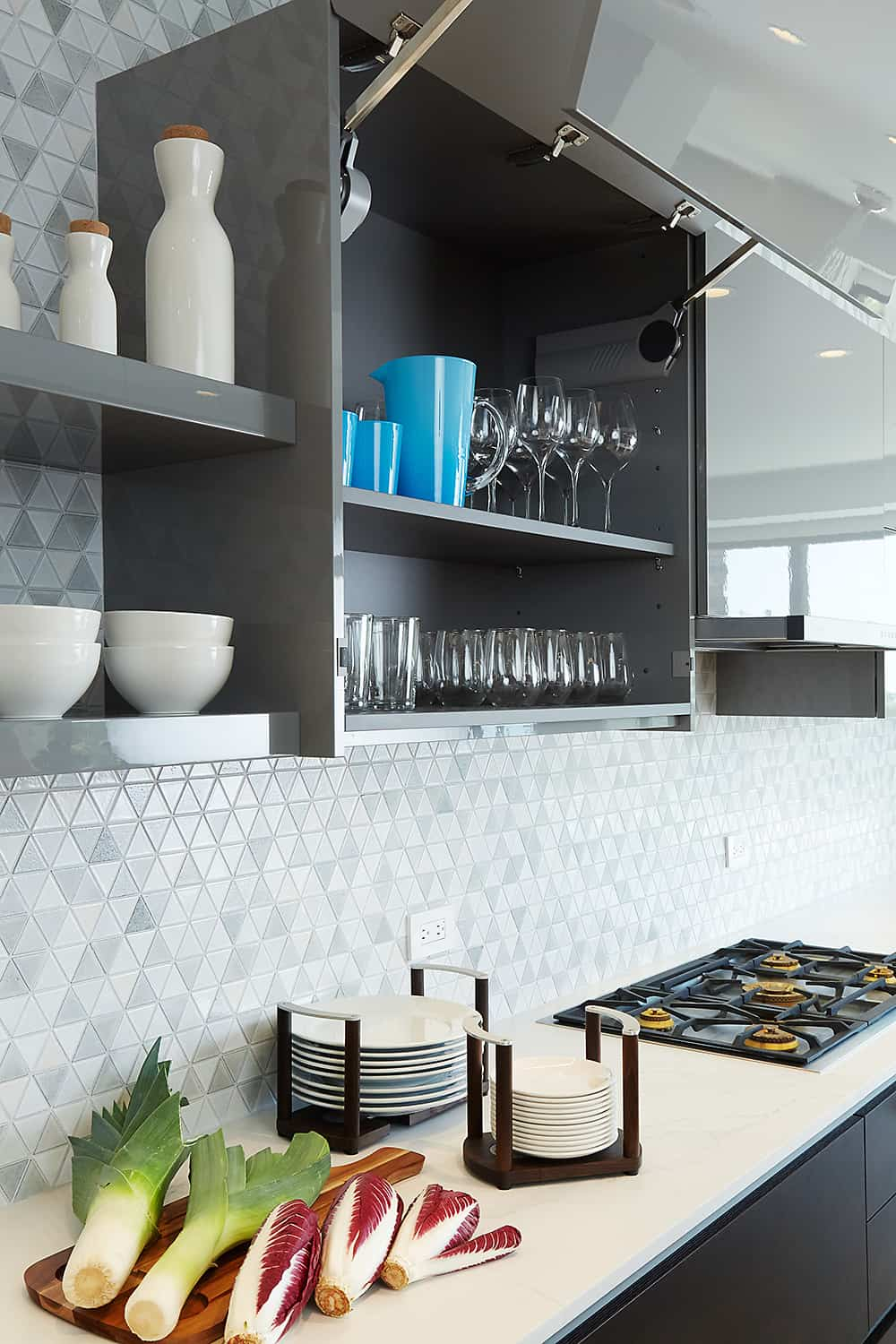 automated opening and closing luxury cabinets of the moussa kitchen project completed by eggersmann la
