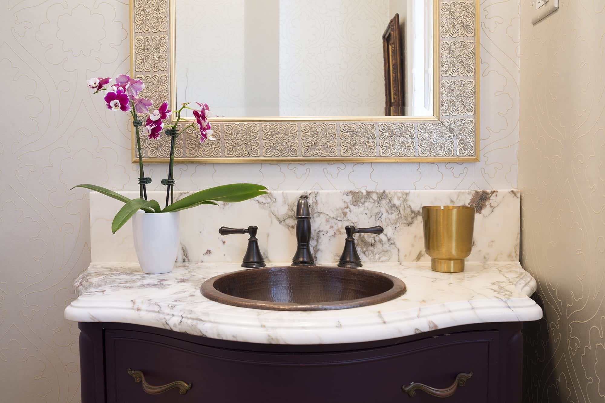 bold choices like a bronze sink are perfect for powder rooms
