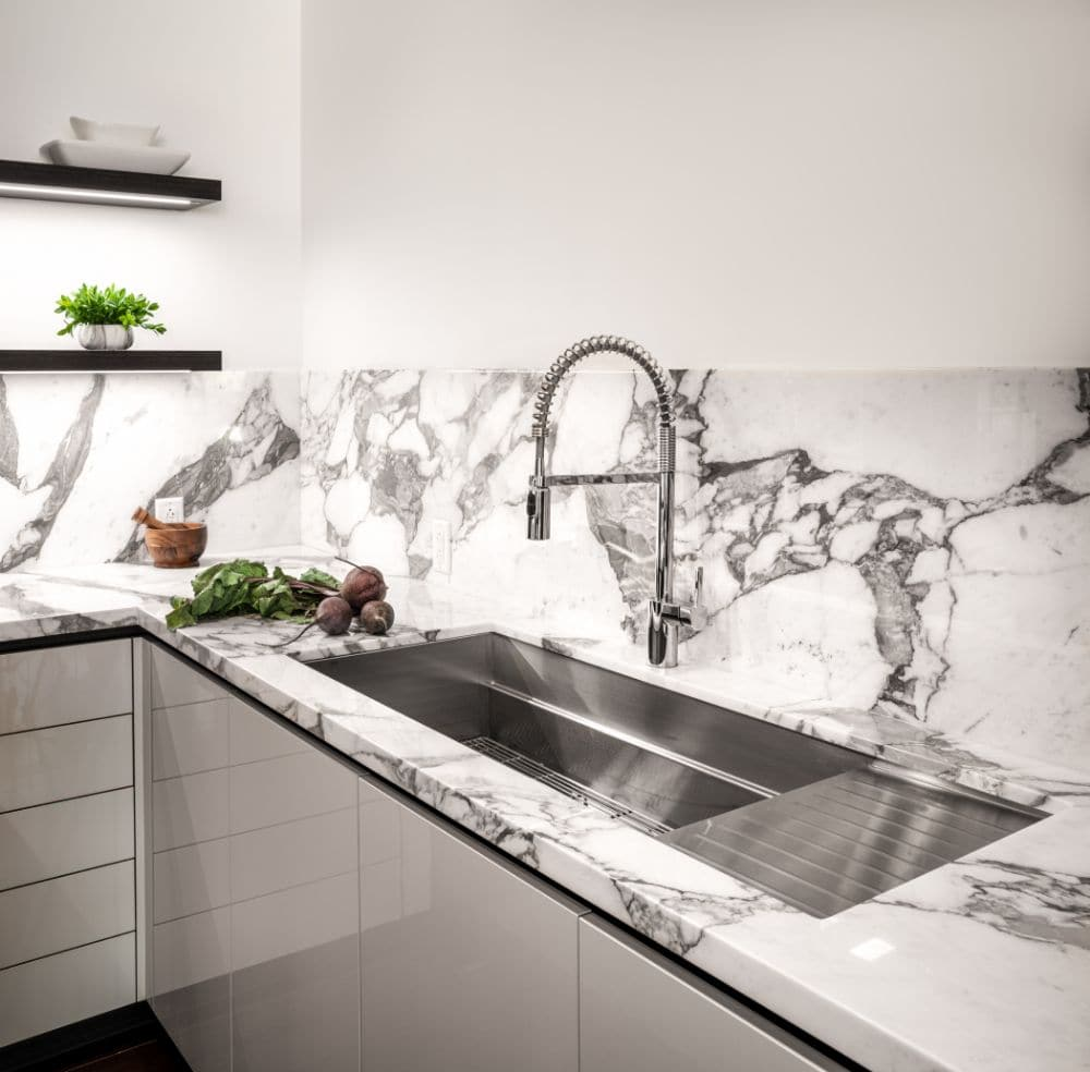 gooseneck pot-filler mounted faucet above a sink by the galley in a german kitchen designed by eggersmann for the paramount highrise in houston
