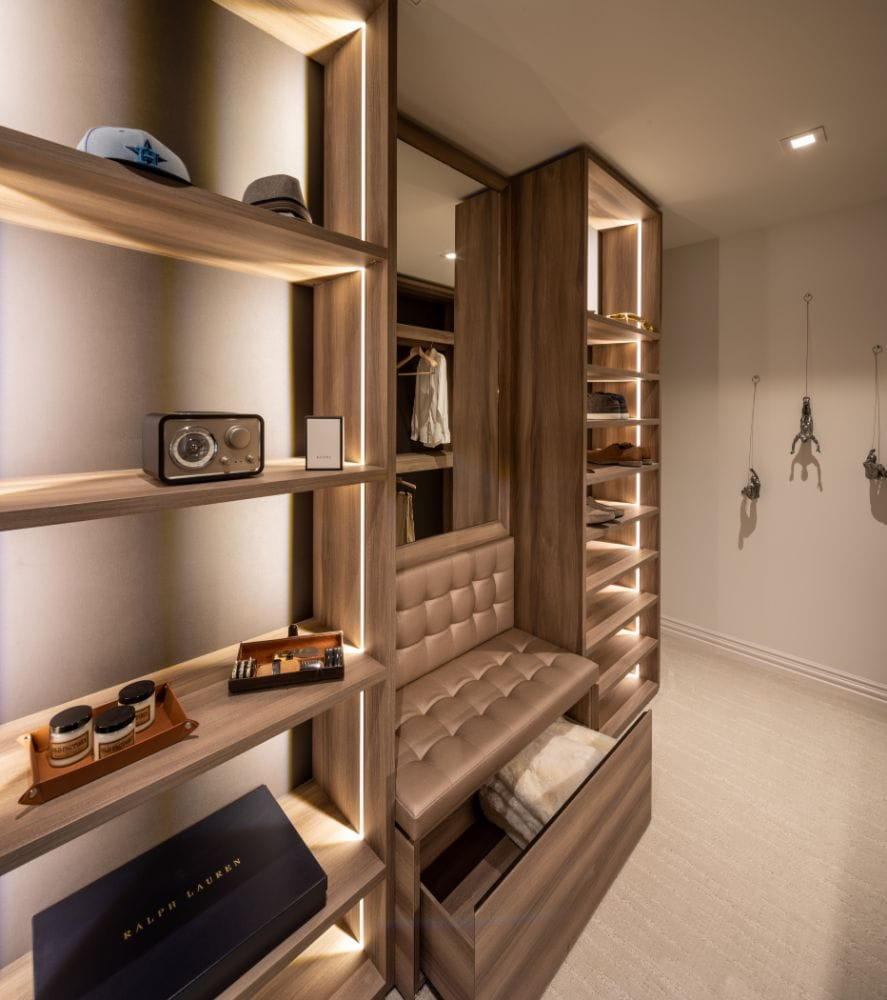 storage shelves in a schmalenbach walk-in closet feature led lighting