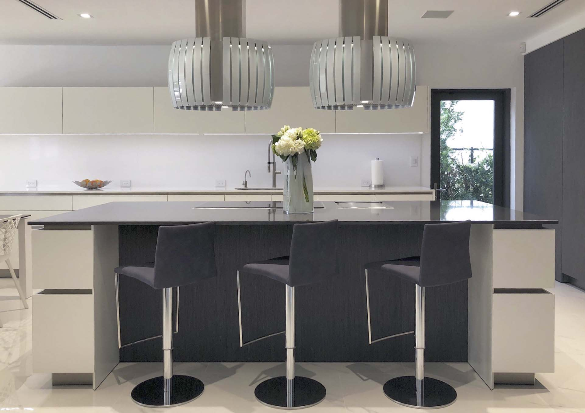 luxury german-crafted kitchen with bespoke barstools is a display kitchen in the eggersmann showroom in dcota in south florida