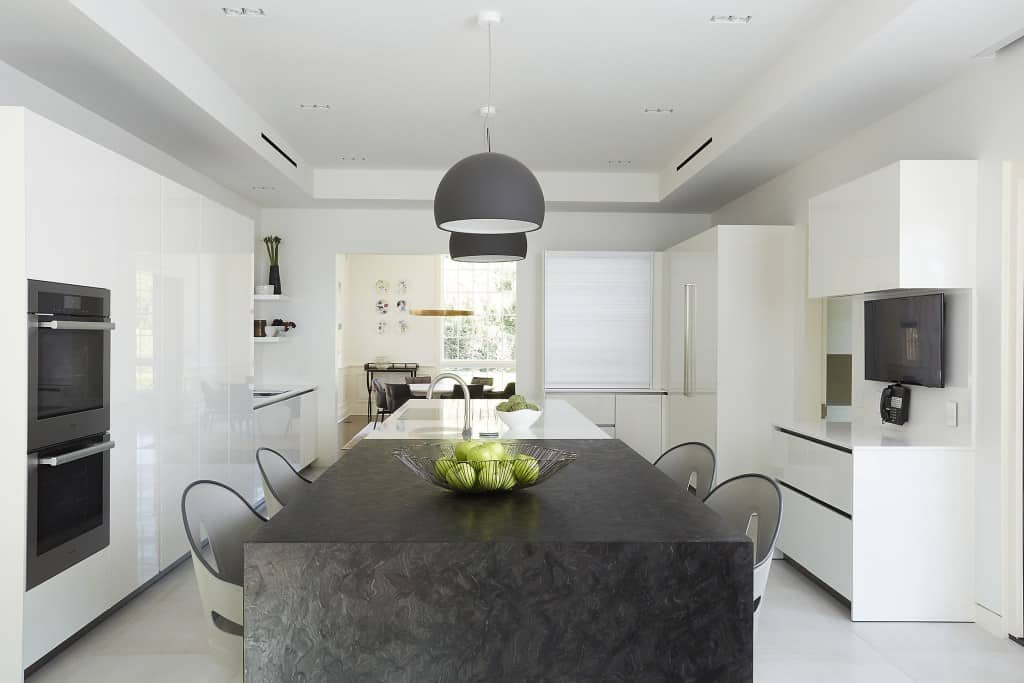 modern bright white and gray with warm toned dining table in a kitchen remodel project featured in modern reduction in california home magazine