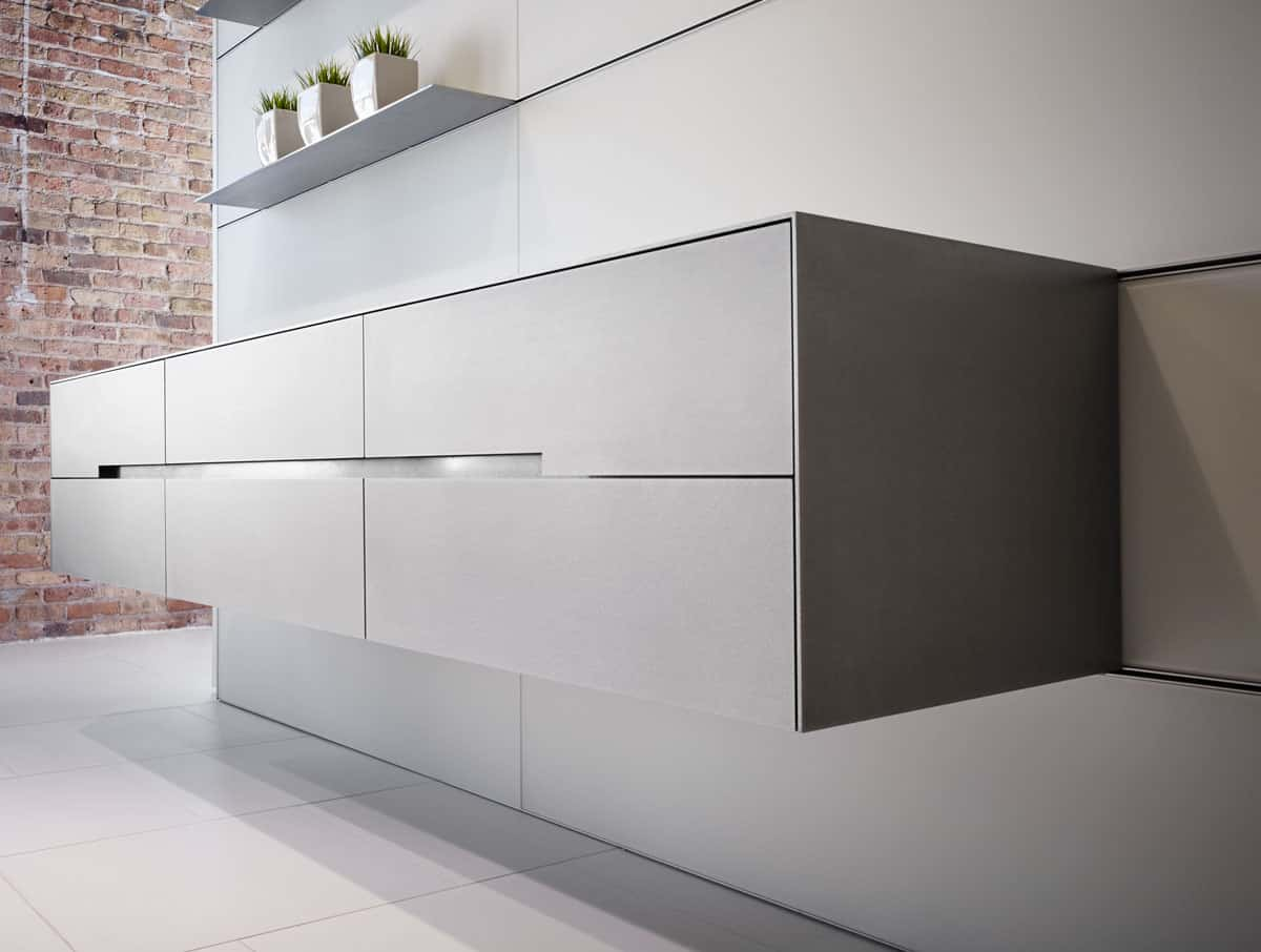 SilverTouch hotrolled Stainless Steel finish on a suspended credenza of Vienna Pianovo Diamond White