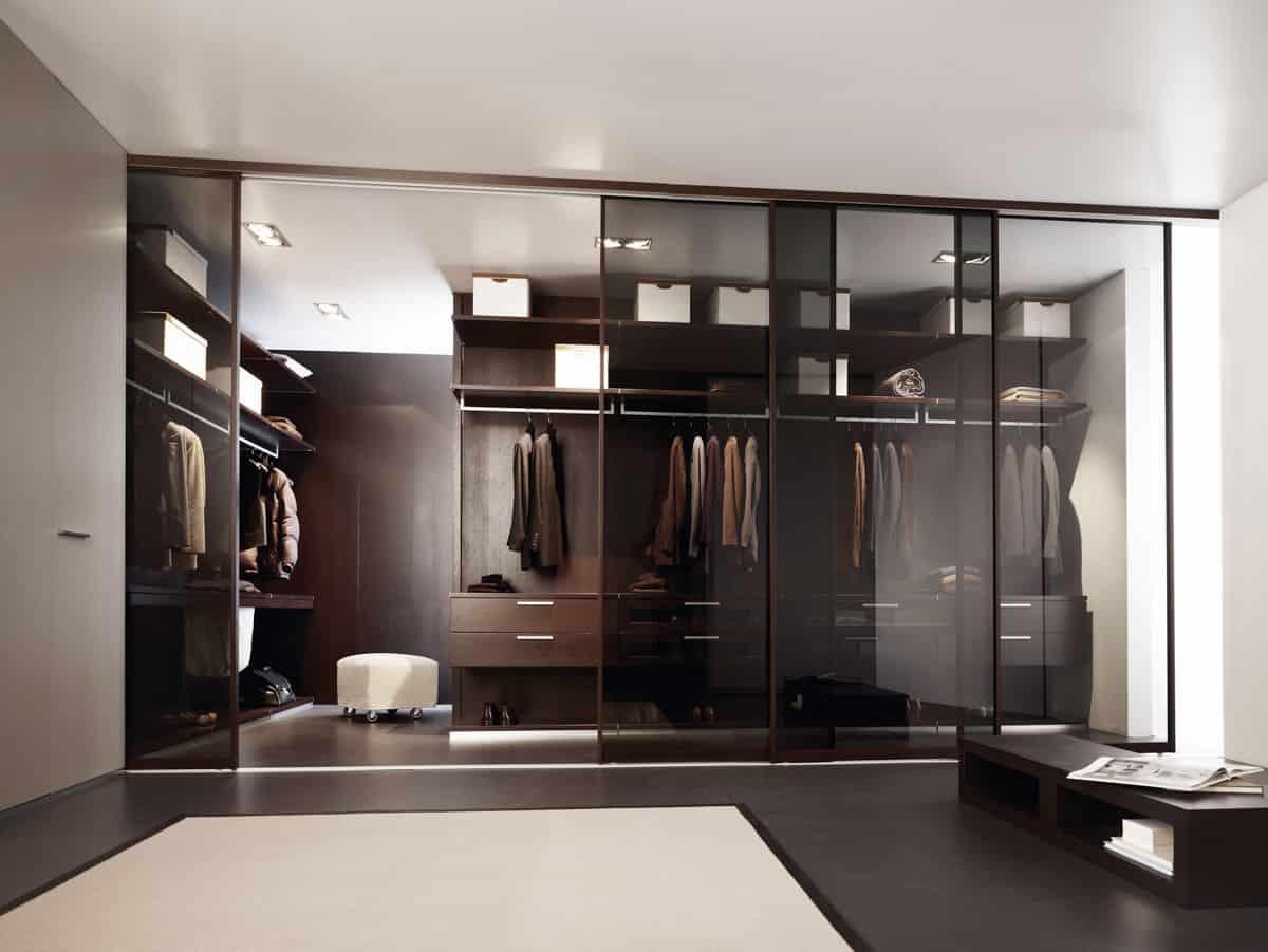 mirrored wall of doors in luxury custom closet by Schmalenbach