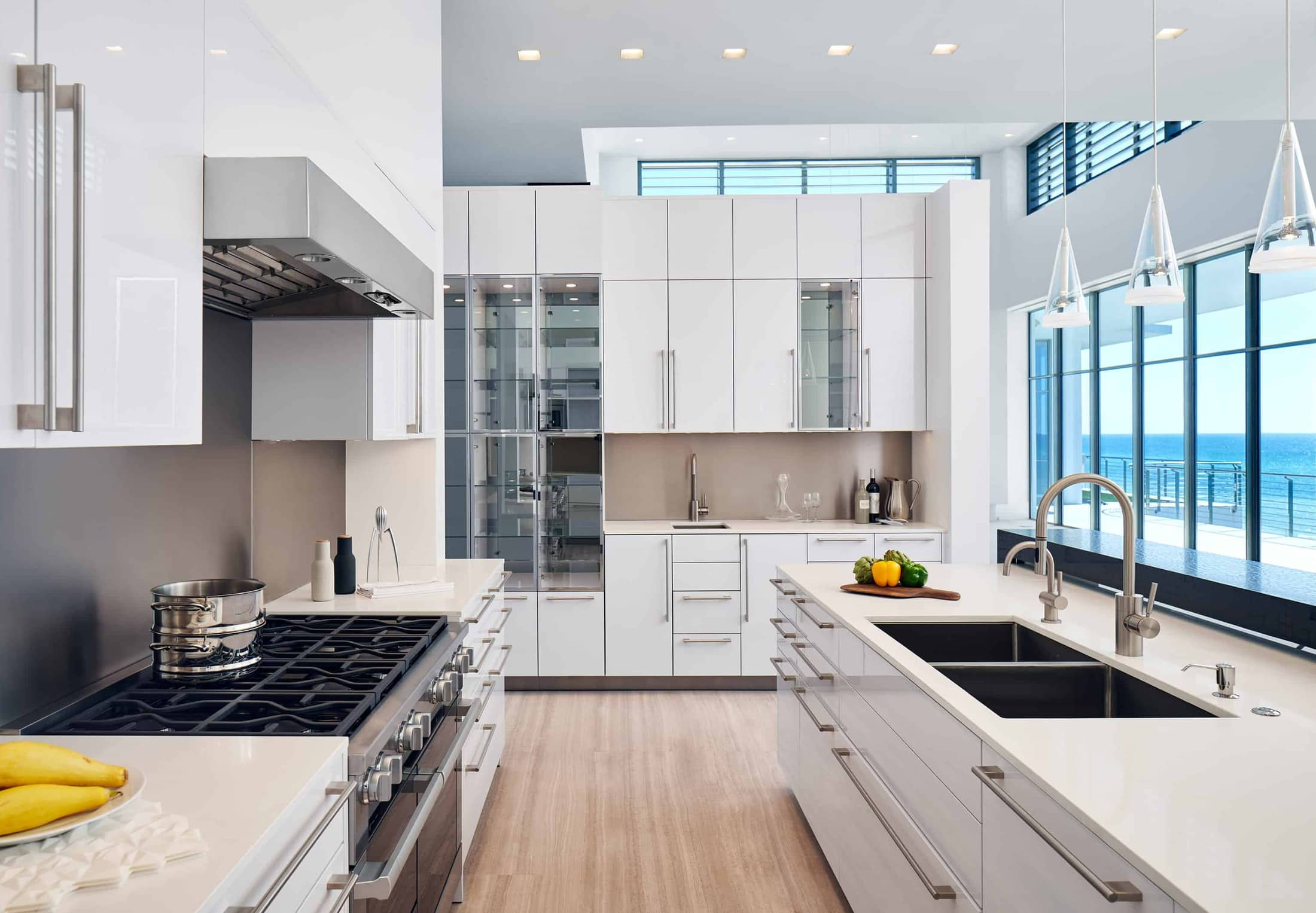 eggersmann-designed modern german kitchen in high gloss white with glass fronts